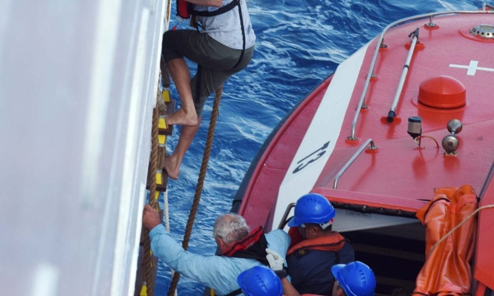 Cruise Ship Rescues Passengers From Sinking Yacht [PHOTOS]